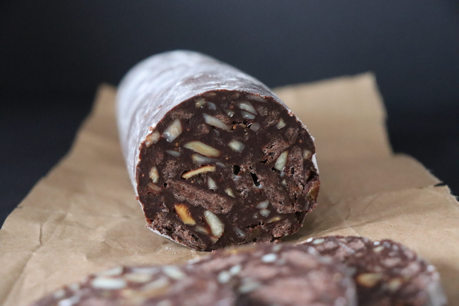 chocolade salami cuted in slices served on a wrapping paper